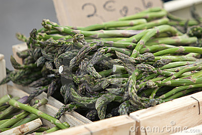 Green asparagus in box at farmers market