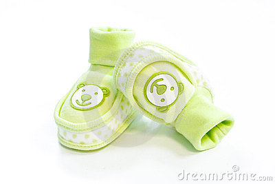 Green baby booties with dots