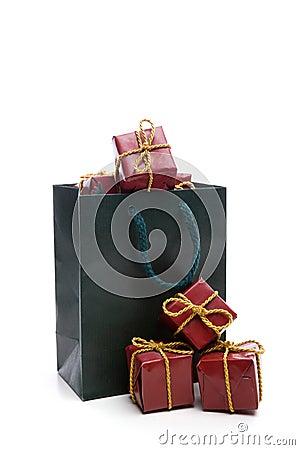 Green bag with small christmas present box