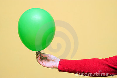 A green balloon in a hand