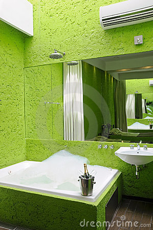 Green bathroom with jacuzzi