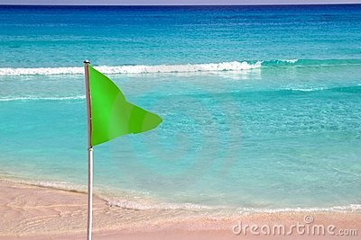 Green beach flag good beach weather