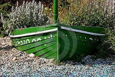 Green boat with flowers