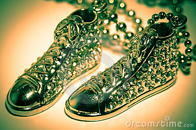 Green boots on necklace