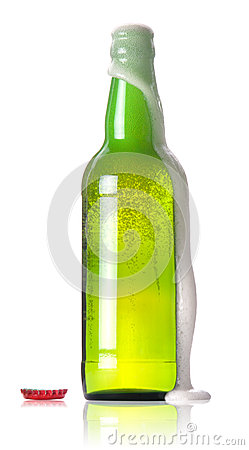 green bottle of beer with a flowing foam