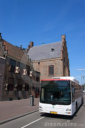 Green Bus in front the Medieval prison