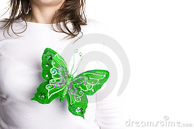 Green butterfly on young woman chest
