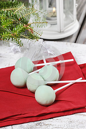 Green cake pops on red napkin