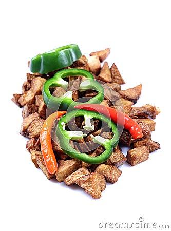 Green capsicum on fried potatoes