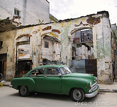 Green car on eroded havana street, cuba
