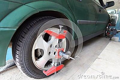 Green car on repair in car-care center