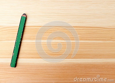 Green carpentry pencil on wood