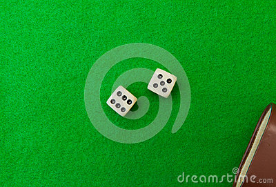Green casino table with dice