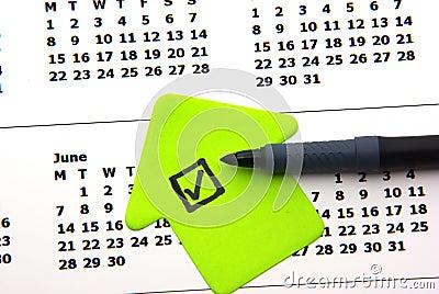 Green checklist on calendar