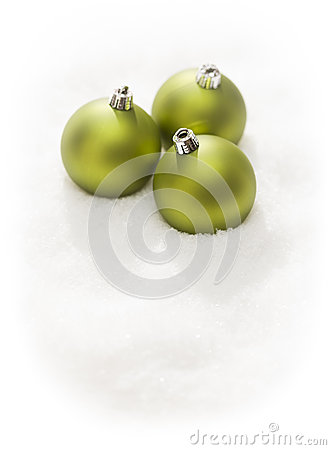 Green Christmas Ornaments on Snow Flakes  on White
