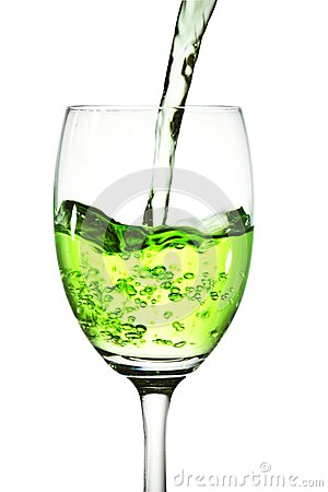 Green cocktail into glass