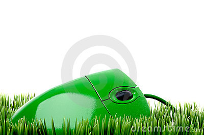A green computer mouse on grass
