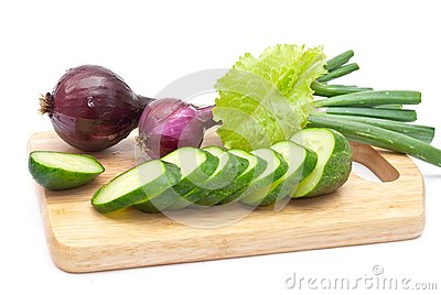 Green cucumber slices with red onion