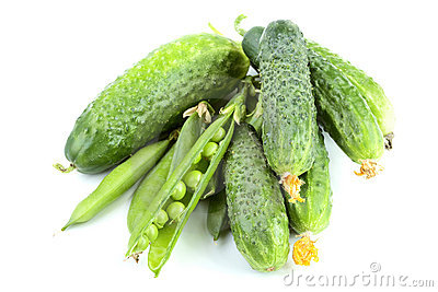 Green cucumbers and peas isolated