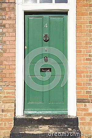 Green Door in a Brick Building