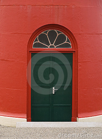 Green door of red lighthouse