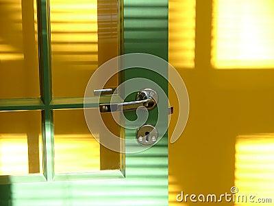 Green door and yellow wall