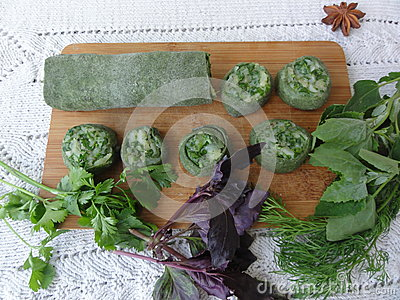 Green dough roll cooked from nettle and wild plants Stock Photo
