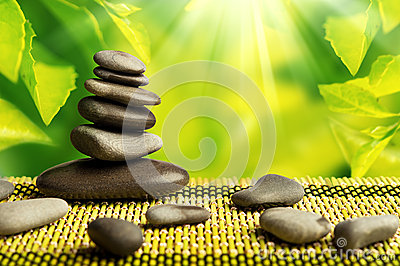 Green eco background, spa stones and leaves