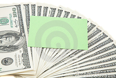 Green empty card on a spread of cash