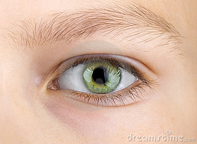 Green eye of child