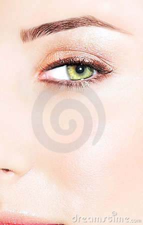 Green eye of a woman