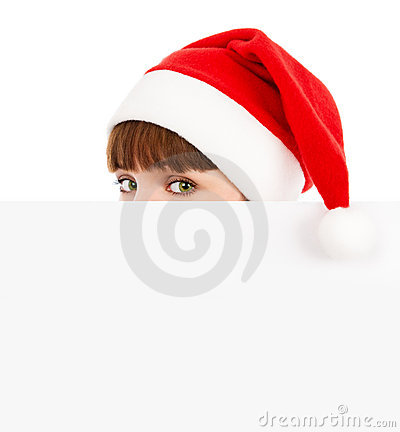 Green-eyed Santawoman peeking over blank billboard