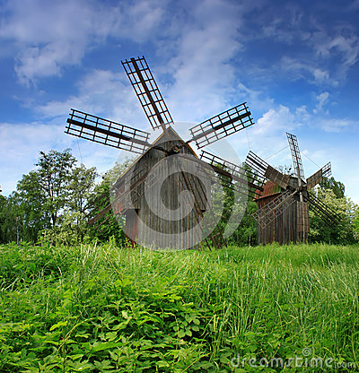 Green field with a windmill