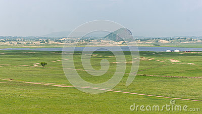 Green fields by river
