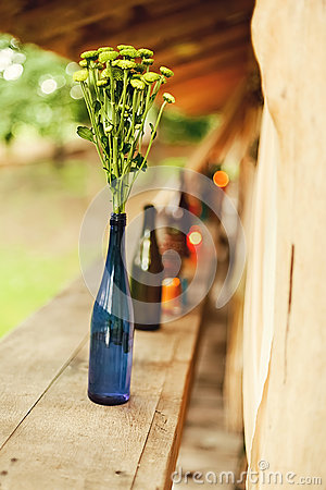 Free Green Flowers In Blue Bottle On Nature Royalty Free Stock Image - 61078376