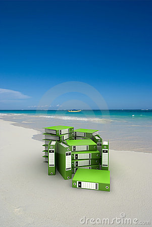 Green folders on the beach