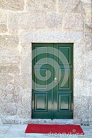 Green front door and red carpet