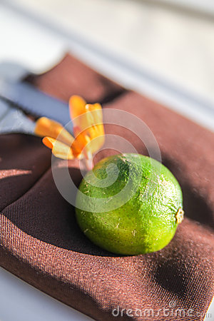 Green fruit on brown napkin