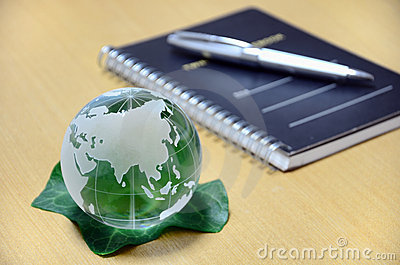 Green glass globe and Note.