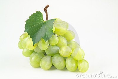 Green grapes with leaf. Isolated on white