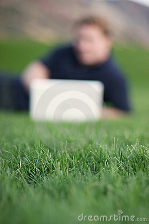 Green Grass, Blurred Computer User