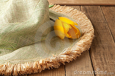 Green Hat with Yellow Tulip on Rustic Wood