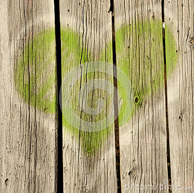 Green heart on old wood