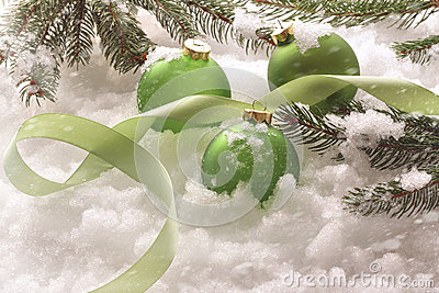Green holiday balls in snow