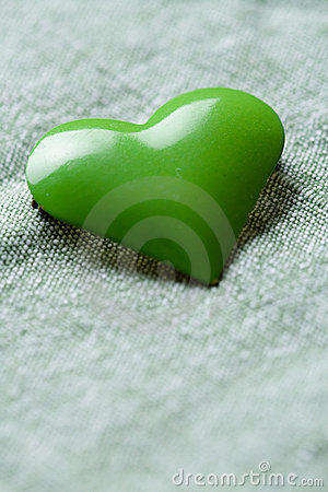 Green iron heart shape on cloth
