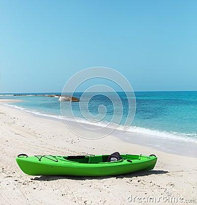 Green kayak on the beach