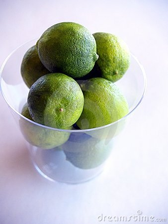 Green key limes in a clear cup