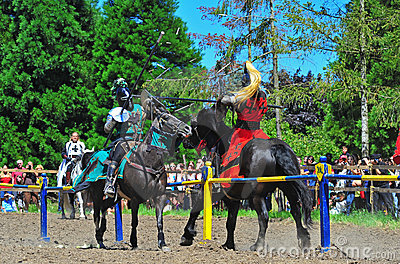 Green knight deflects the red knight s hit Editorial Photo