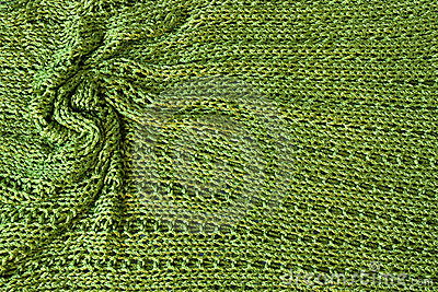 Green knit background with twisted folds