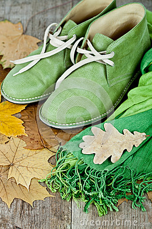 Green leather boots, scarf and yellow leaves
